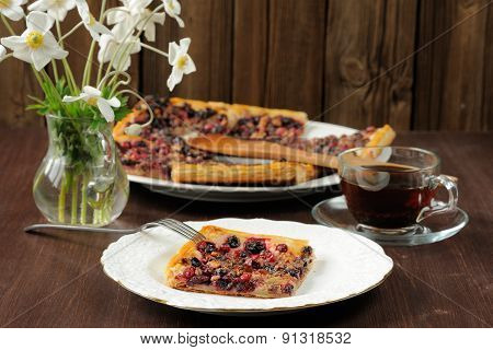Berry Pie With Puff Pastry Cut Served With Tea In Glass Cup And White Anemones