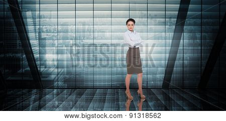 Businesswoman with arms crossed against room with large window looking on city