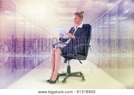 Businesswoman sitting on swivel chair with tablet against digitally generated server room with towers