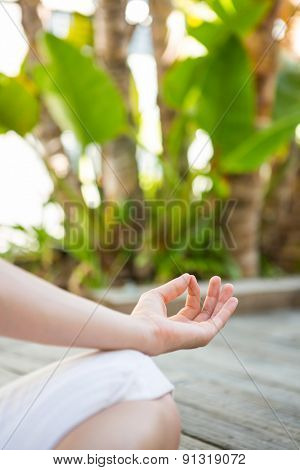 Woman meditating outside on a sunny day