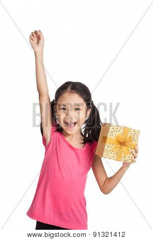 Little Asian Girl With Gift Box Push Her Hand Up
