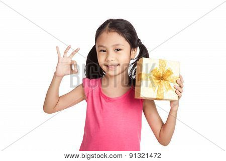 Little Asian Girl With Gift Box Show Ok Sign