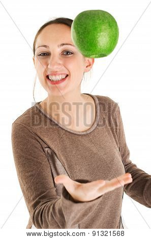 Woman Juggling With Green Apple