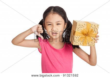 Little Asian Girl With Gift Box Show Thumbs Down