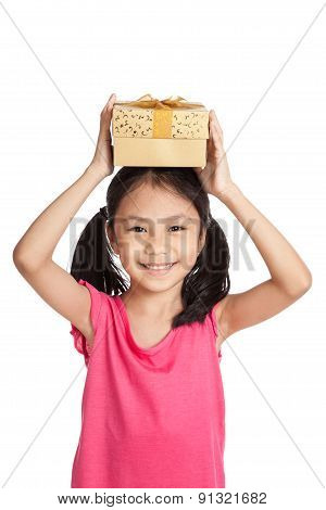 Little Asian Girl With Gift Box Over Her Head