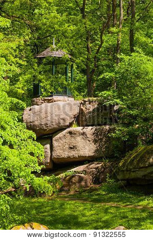 Arbor On Large Rocky Boulders