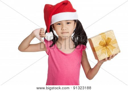 Little Asian Girl With Santa Hat And Gift Box Thumbs Down