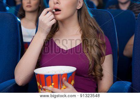 Eating Popcorn At The Cinema.