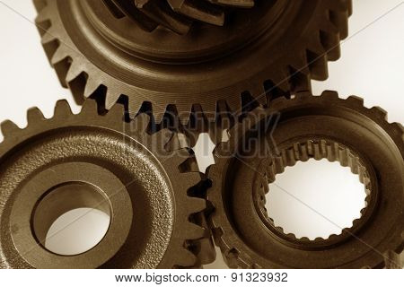 Closeup of three steel gears