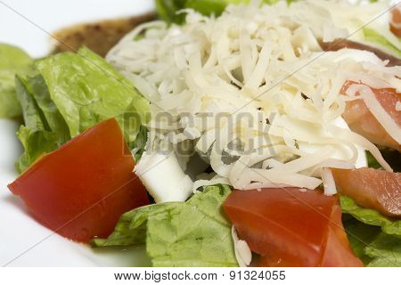 Closeup of salad with vegetables and fish