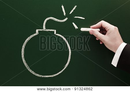 bomb sketch on blackboard risk and danger concept