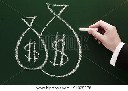 money bag sketch on blackboard by businessman