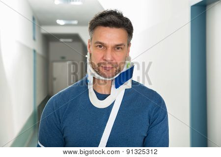 Disabled Man Using Cervical Collar
