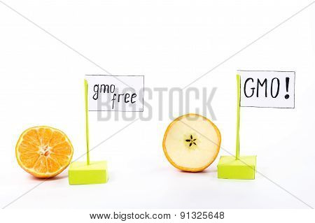 gmo and gmo free fruits - orange and apple