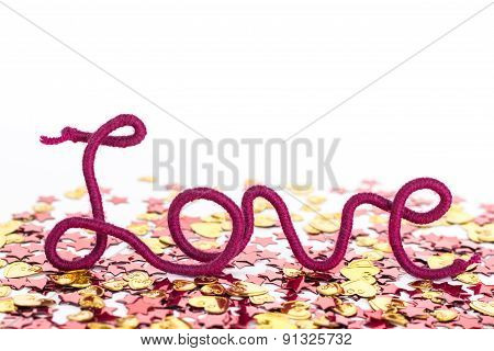 isolated word love of red thread on sparkles background