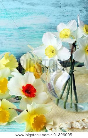 Fresh narcissus flowers on wooden background