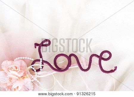 word love of red thread on fabric background. View from above.