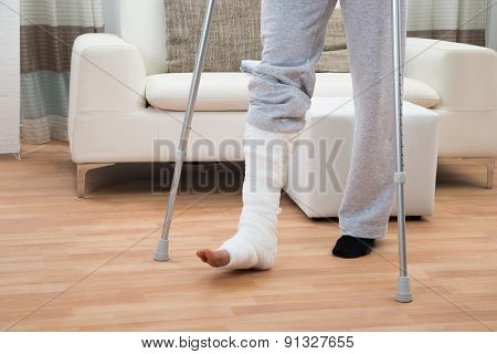 Man Using Crutches For Walking