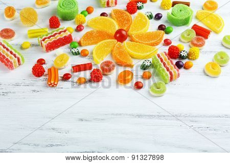 Colorful candies on wooden background