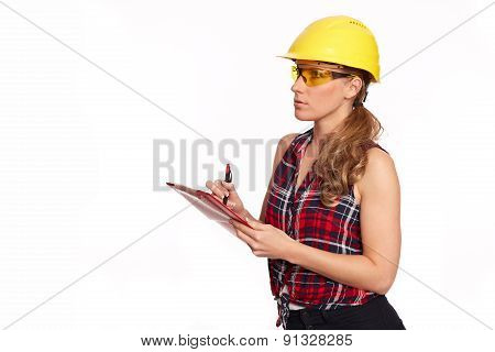 Young Woman With Hard Hat And Writing Board