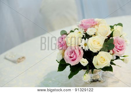 Roses Bouquet On A Restaurant Table
