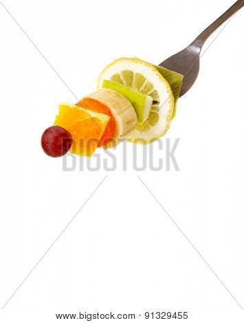 Snack of fruits on fork isolated on white