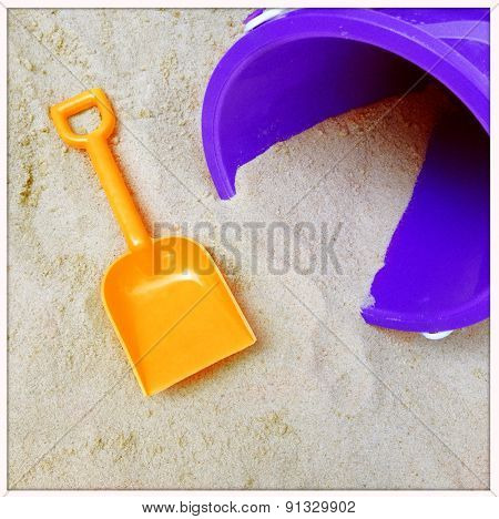 Instagram filtered image of a to shovel and pail in the sand