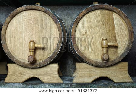 Two Oak Wooden Barrels On Racks.