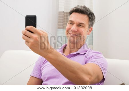 Man Holding Cellphone