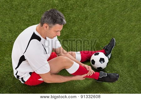 Soccer Player With Injury In Leg