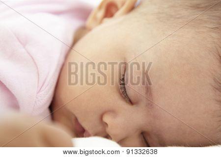 Close Up Of Sleeping Baby Girl At Home