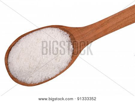 Top View Of Salt In A Wooden Spoon On A White