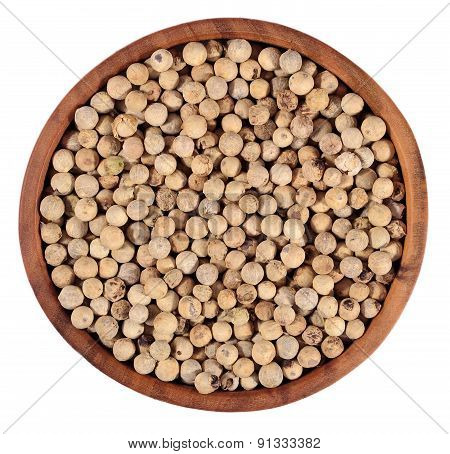 White Pepper Seeds In A Wooden Bowl On A White