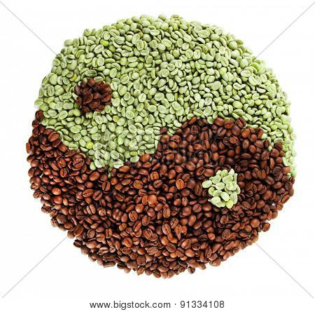 Green and brown coffee beans (yin yang) isolated on white