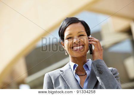 Businesswoman on phone outdoors