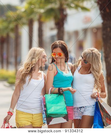 Buy and tourism - beautiful girls with shopping bags for shopping in the city.