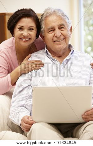 Senior Hispanic couple with laptop