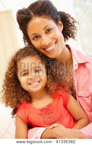 Mixed race woman and daughter at home