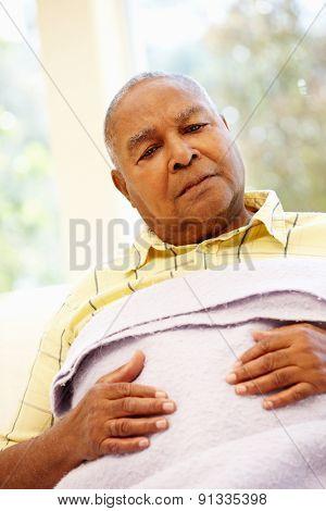 Unwell senior African American man
