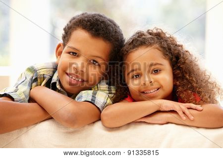 Mixed race girl and boy at home