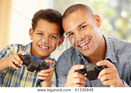 Father and son playing computer games