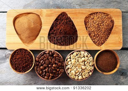 Various of coffee in small dishes on wooden table, top view