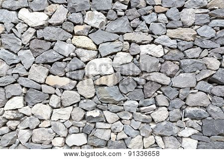 Grey stone wall as background