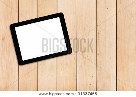 Tablet Pc On A Wooden Table
