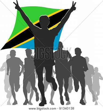 Athlete With The Tanzania Flag At The Finish