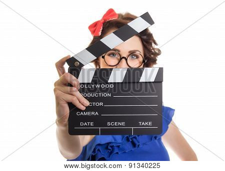 Young Girl Holding Movie Clapper Board Isolated On White