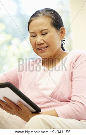 Senior Asian woman using tablet
