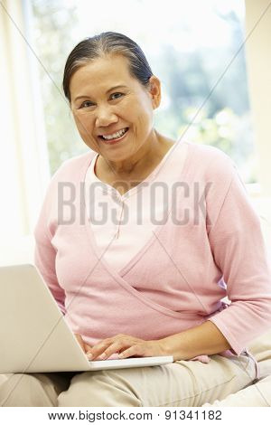 Senior Asian woman using laptop