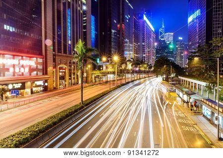 traffic light trails and modern street