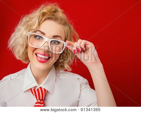 Smile Woman  Wearing Eyeglasses And Looking You, Isolated On Red Background